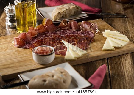 Bacon with cheese bread and olive oil on wooden cutting board