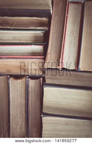 vintage tone of Old and used hardback book or text books seen from above.