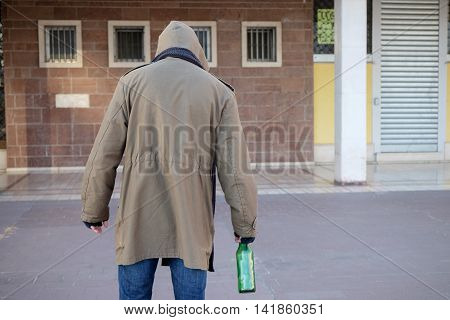 Homeless Drunk And  Alcohol Addicted Walking Alone