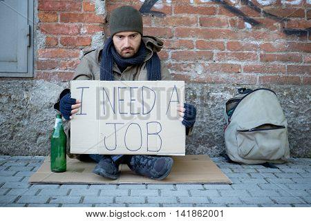 Homeless Lying On The Street Alone