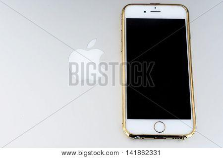 Apple Logo On A Brushed Aluminum Background And Phone