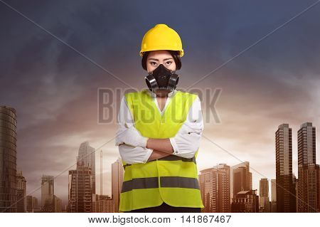 Women contractor she wearing mask and yellow helmet to keep safety