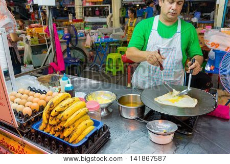 Koh Samui Thailand - Jun 29 2016. Thai people cooking fresh banana roti in Koh Samui Thailand