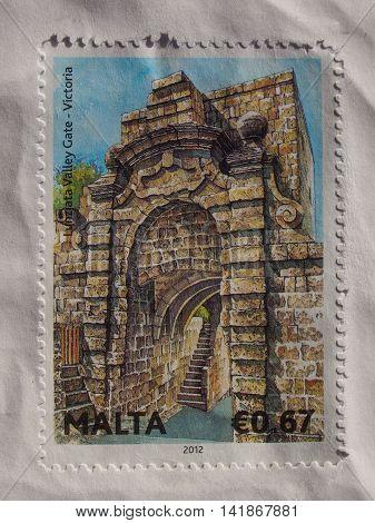 VICTORIA MALTA - CIRCA DECEMBER 2013: A stamp printed by Malta shows Lunzjata Valley Gate in Victoria