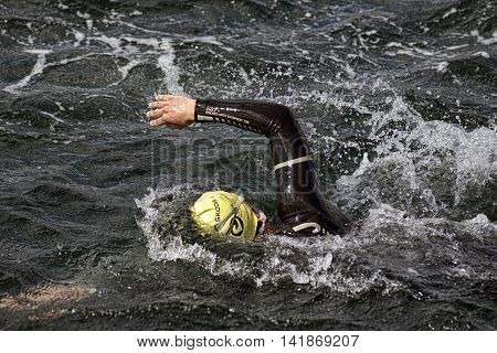 FREDERICIA DENMARK - AUGUST 6 2016: Triathlet swimming the triathlon competition Challenge Denmark in Fredericia Harbor August 6 2016.