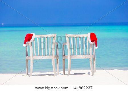 Close-up santa hat on chair longue on tropical caribbean beach
