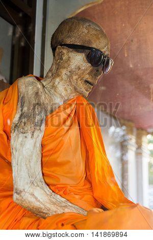 Koh Samui island Thailand - July 4 2016. Mummified monk in Koh Samui island Thailand
