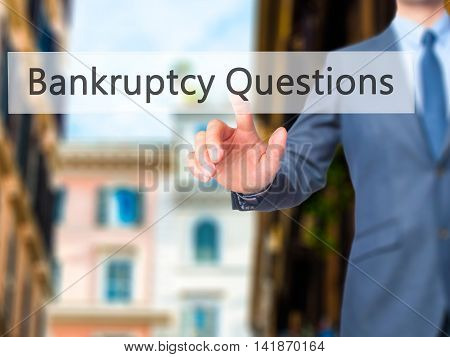 Bankruptcy Questions - Businessman Hand Pressing Button On Touch Screen Interface.