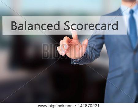 Balanced Scorecard - Businessman Hand Pressing Button On Touch Screen Interface.