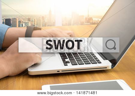 SWOT SEARCH WEBSITE INTERNET SEARCHING man hand work hard