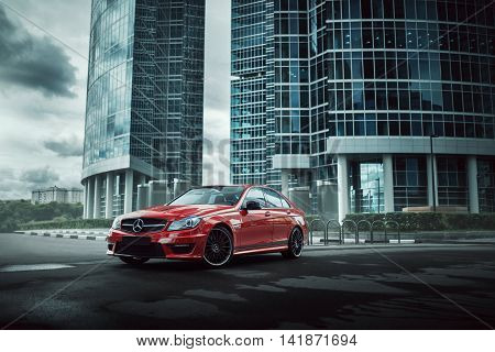Moscow, Russia - July 10, 2016: Red Car Mercedes-benz C63 Amg Stay On Asphalt Road In The City Mosco