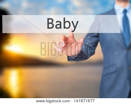 Baby - Businessman Hand Pressing Button On Touch Screen Interface.