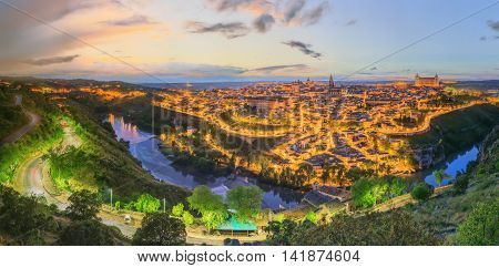 Night view of Toledo cityscape and Tagus River from the hill, Castilla la Mancha, Spain.