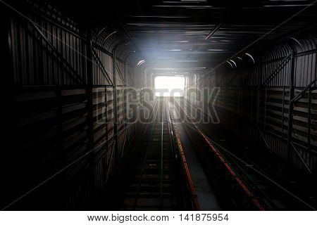 Light At Way Out Or Exit Rail Or Track Lane In Tunnel