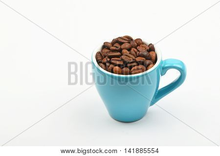 Blue Espresso Cup Full Of Coffee Beans Over White