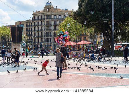 Barcelona Spain - April 3 2016: People walking along the Catalonia Square (Plaza de Cataluna) is a large square in central Barcelona