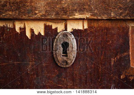 Rusty Keyhole In Old Wooden Wardrobe