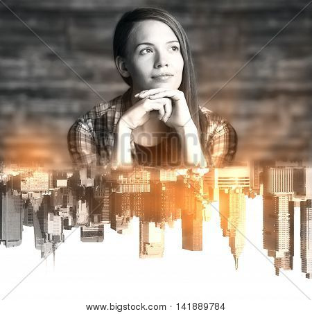 Thoughtful young woman with abstract upside down city reflection