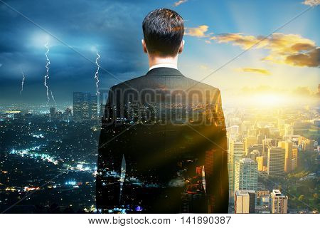 Research concept with back view of businessman looking into the distance on stormy and sunny city background. Double exposure