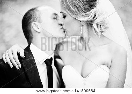 Close Up Portrait Of Kissing Wedding Couple