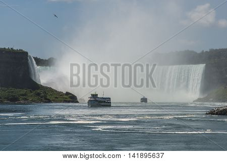 Niagara Falls, Canada-6 August, 2013 : boat of Tourists on the Niagara Falls