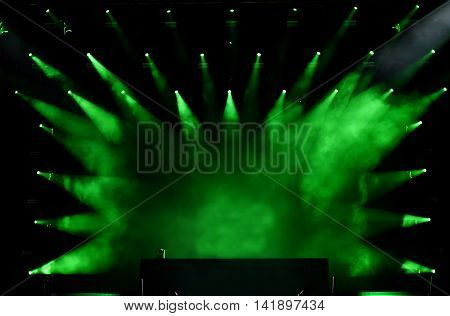 Green stage projecting on empty stage lights