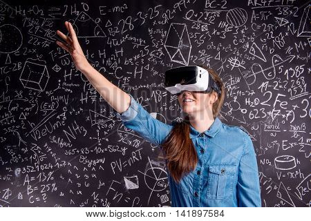 Beautiful Woman Wearing Virtual Reality Goggles Against Big Blac