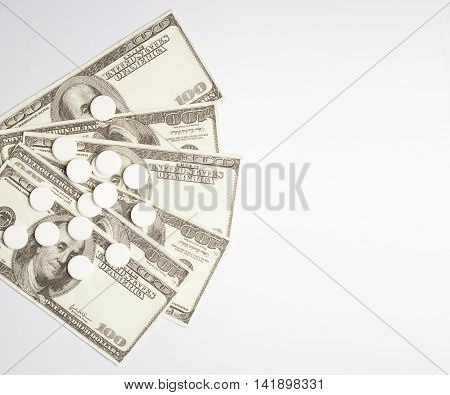 White pills and money health expense concept health care cost medical business