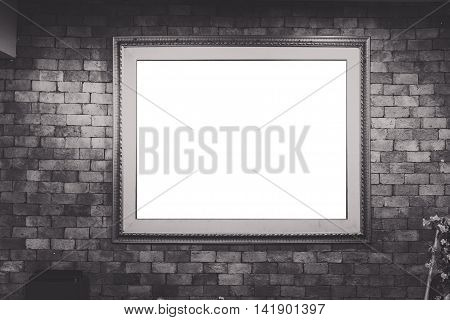 Blank Antique Picture Frame On Brick Wall, Vignetting Around (black And White Picture)