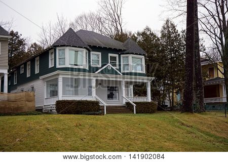 WEQUETONSING, MICHIGAN / UNITED STATES - DECEMBER 22, 2015: A green and white home on Beach Drive in Wequetonsing, Michigan.