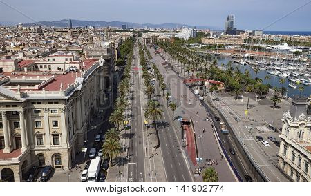 BARCELONA SPAIN - JULY 4 2016: La Barceloneta and Port Vell marina from Christopher Columbus monument in Barcelona Catalonia Spain