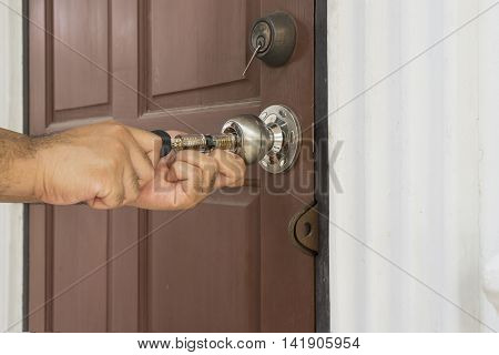 locksmith use his tool open the old wood door