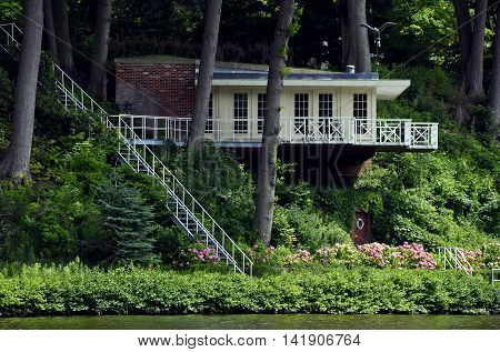 Summer cottage with long stairway overlooking river