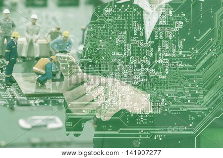 double exposure of businessman and network repairing and mainboard filter on image - can use to display or montage on product or concept make a best communication