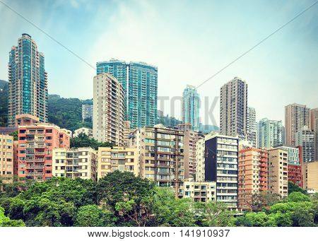 View on residential area of Hong Kong with high-rise apartment buildings rising over Hong Kong Park