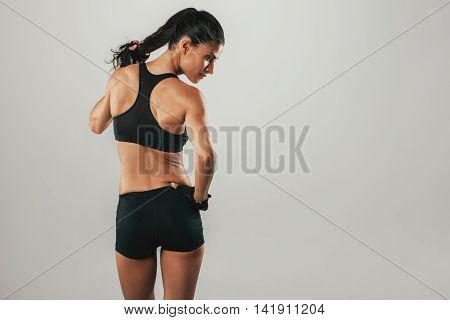 Rear View Of Fit Woman Looking Sideways