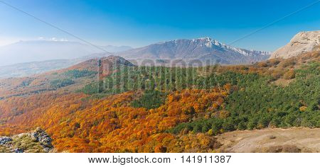 Panoramic landscape in Crimean mountains at fall season - view from mountain pasture Demerdzhi to Chatyr-Dah mountainous massif