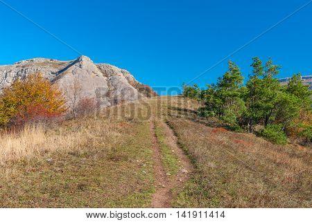 Hiking path to Bald Ivan mountain at autumn season - mountain pasture Demerdzhi Crimean peninsula