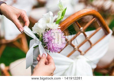 Decorator Working With Flowers Composition For Chair.