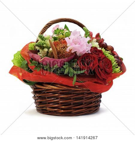 Wicker basket with flowers isolated on white background. Assorted floral gift. Red roses for the anniversary. Floristry design.