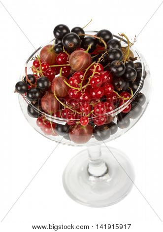 Fresh garden berries in a vase over white background