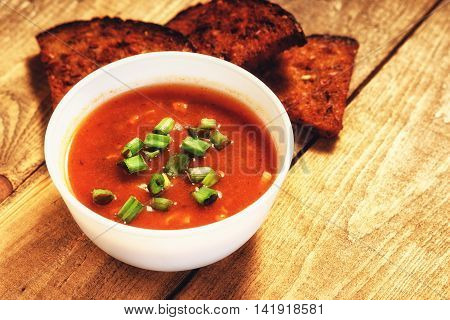 Goulash soup and sliced bread on a table