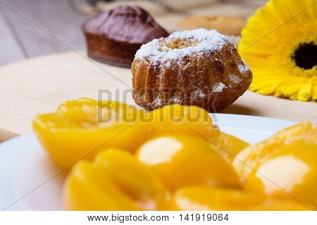 Muffins, peaches and gerber on a table
