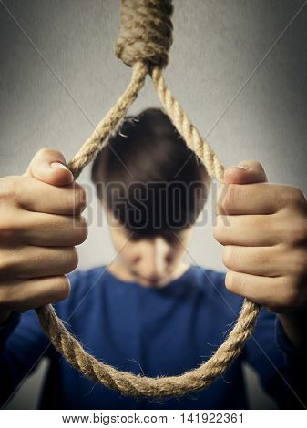 the girl holds with hands before herself a rope with Lynch's loop