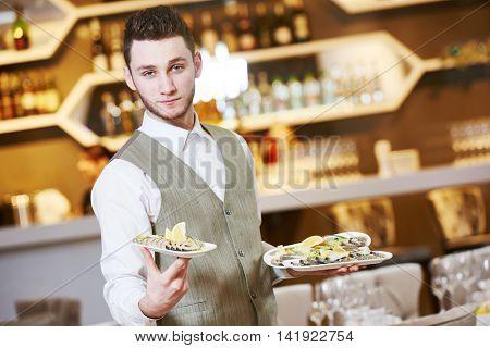 Waiter man in restaurant. Catering