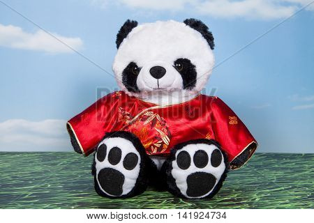 A panda wearing a traditional red changshan