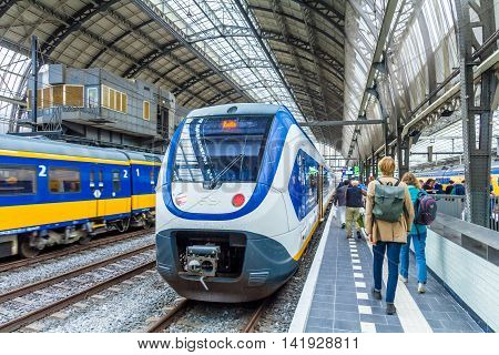 Amsterdam the Netherlands - August 08 2016: passengers boarding a train