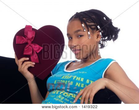 Young Girl Showing A Heart