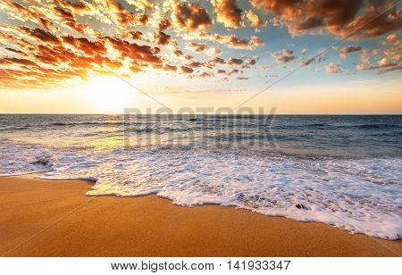 Beautiful sunrise over the tropical beach. Golden sands
