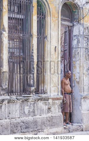 HAVANA CUBA - JULY 18 : A Cuban man in old Havana street on July 18 2016. The historic center of Havana is UNESCO World Heritage Site since 1982.